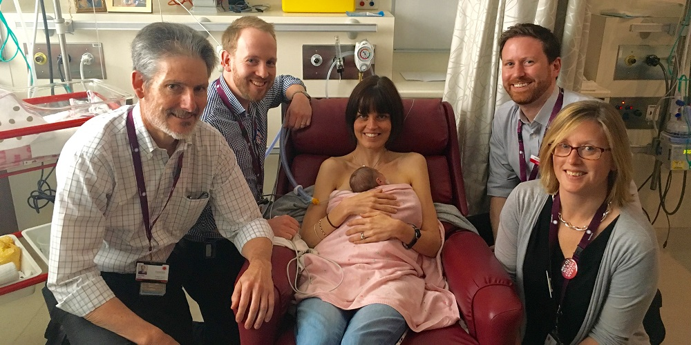 The Women's Neonatal Research Team: Prof Peter Davis, Dr Brett Manly, Dr Calum Roberts and Dr Louise Owen with mum Celia and her newborn Eli